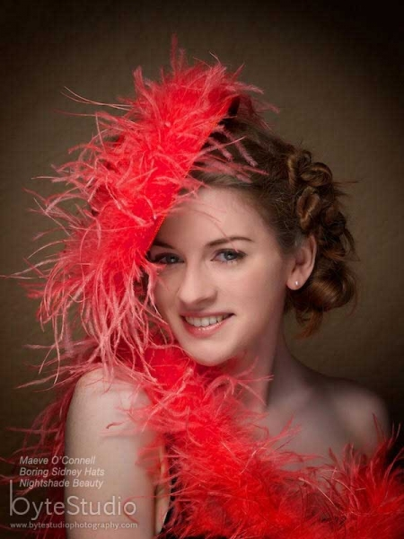 Woman in a feather trim hat