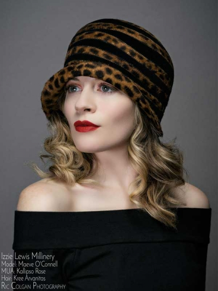 Woman in a spotted hat designed by Izzie Lewis Millinery