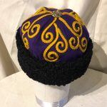 Purple hat with gold embroidery and faux caracul lamb trim