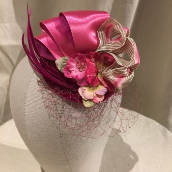 Pink Fascinator hat with ribbon and feathers